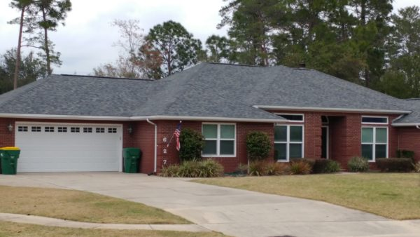 Image of a home shingled in Duration Estate Grey by Taylor Enterprises Inc.