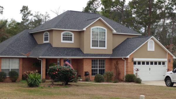 Image of a home shingled in Oakridge Twilight Black by Taylor Enterprises Inc.