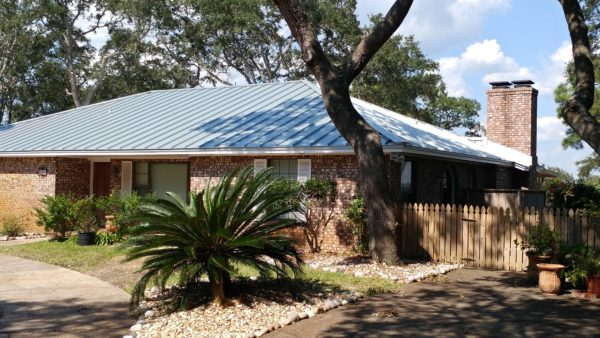 Image of a home roofed in metal with a standing seam by Taylor Enterprises Inc.